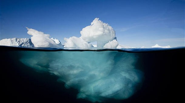 One Man's Ten Year Quest To Capture The Beauty Of Arctic Sea Ice Before It Disappears Forever...***EXCLUSIVE*** ILULISSAT, GREENLAND - UNDATED: An underwater image of icebergs floating near the face of Jakobshavn Isfjord on a summer afternoon in Ilulissat, Greenland. This stunning environment is so fragile and rarely visited you would be forgiven for thinking it was ice to see you. In the week Britains leading climate change scientist warned that Arctic sea ice could vanish in as little as FOUR years time, an award winning nature photographer has released pictures of his incredible ten year quest to capture the beauty of icebergs in all their glory. Prof Peter Wadhams, of Cambridge University, said that Arctic ice is vanishing so rapidly thanks to global warming that it could be a thing of the past shockingly soon. The pictures show how just as the serene beauty of the Arctic ice cap was at its most still the dynamic force of the melt erupted  causing tons of ice to smash into the ocean. Recent winner of the